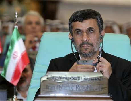 Iranian President Mahmoud Ahmadinejad looks on at the opening ceremony of the Organisation of Islamic Conference (OIC) summit in Mecca August 14, 2012.