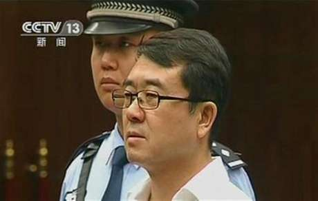 Former police chief Wang Lijun attends a court hearing in Chengdu in this still image taken from video September 18, 2012.