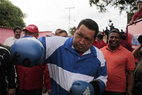 Venezuela's President Hugo Chavez poses using boxing gloves during a campaign rally in Acarigua in the state of Portuguesa September 24, 2012.