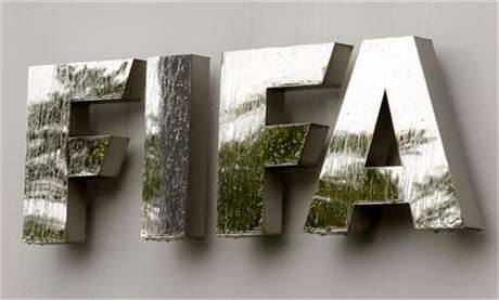 Water flows over the FIFA logo in front of the FIFA headquarters during heavy rainfall in Zurich July 22, 2011.