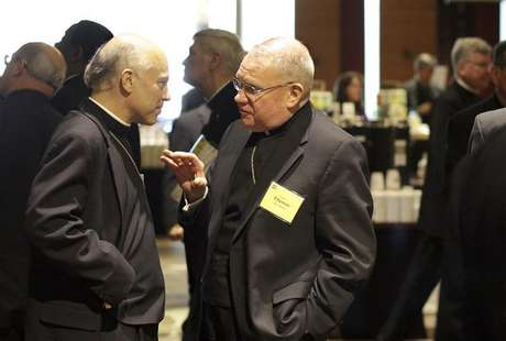 Bishop Salvatore Cordileone and Bishop Walter Edyvean chat after an executive session of United States Conference of Catholic Bishops Spring General Assembly in Bellevue, Washington, June 16, 2011.