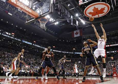Toronto Raptors Andrea Bargnani puts up a shot over Indiana Pacers David West (21) during the first half of their NBA basketball game in Toronto October 31, 2012.