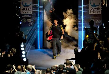 Andy Murray of Britain walks onto court to play Tomas Berdych of Czech Republic in their men's singles tennis match at the ATP World Tour Finals in the O2 Arena in London November 5, 2012.