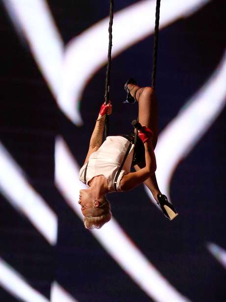 Being a pop star requires some serious strength for strenuous performances but these ladies take that to the next level getting high up on the air in swings. Here, Pink hangs upside down at the MTV Video Music Awards 2012.