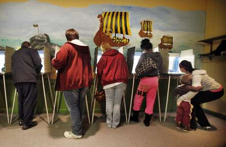 In the Photo, a great number of Americans put in their vote in Akron Ohio. Long lines have been the norm in many of the states, especially swing states like Ohio.