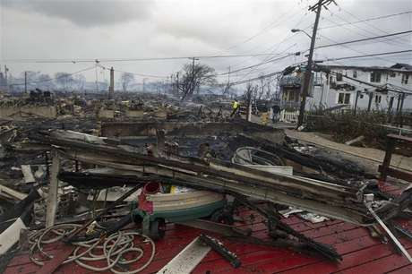 Homes that are devastated by fire and the effects of Hurricane Sandy are seen at the Breezy Point section of the Queens borough of New York in this October 30, 2012, file photo.