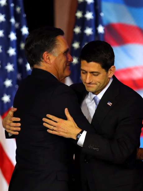 Mitt Romney and Paul Ryan embrace as they accept defeat Wednesday night.
