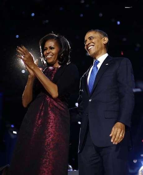 O presidente dos EUA, Barack Obama, e a primeira-dama, Michelle Obama, após o discurso da reeleição, em Chicago. 07/11/2012