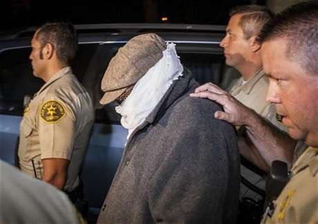 Nakoula Basseley Nakoula (C) is escorted out of his home by Los Angeles County Sheriff's officers in Cerritos, California September 15, 2012.