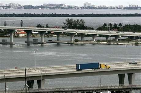A truck transports a container into a port of Miami, October 4, 2007.
