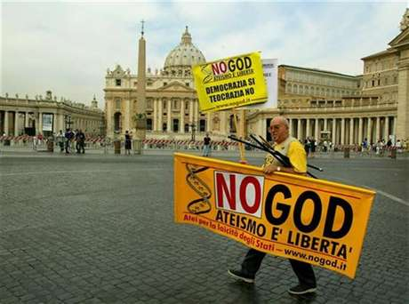 A demonstrator walks with a banner during a pro-gay protest outside Saint Peter's Square in Rome.