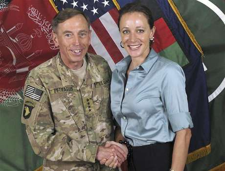Commander of the International Security Assistance Force/U.S. Forces in Afghanistan General David Petraeus shakes hands with author Paula Broadwell in this ISAF handout photo originally posted July 13, 2011.