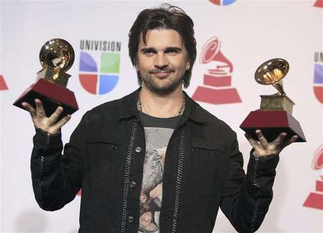 "Juanes poses backstage with the awards for best long form music video and album of the year for ""MTV Unplugged"" during the 13th Latin Grammy Awards in Las Vegas, Nevada, November 15, 2012."