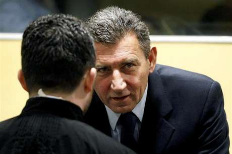 Ante Gotovina (L), who was commander in the Split district of the Croatian army, and Mladen Markac (R), a former Croatian police commander, enter the courtroom of the Yugoslav war crimes tribunal (ICTY) for their appeal judgement in The Hague November 16, 2012.