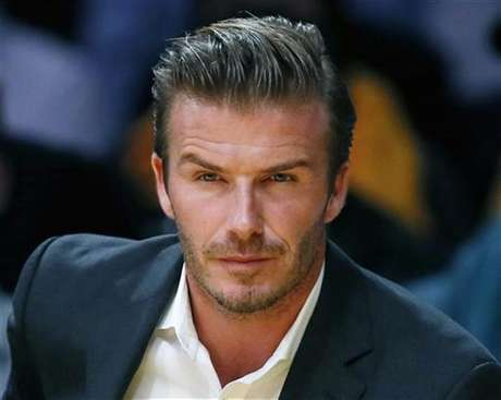 British soccer star David Beckham sits courtside as the Los Angeles Lakers play the Dallas Mavericks during their NBA basketball game in Los Angeles, October 30, 2012.