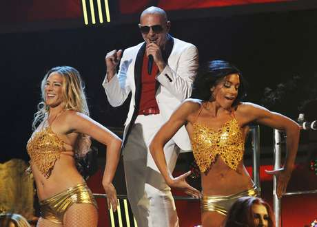 BEST: Pitbull opening performance of 'Don't Stop the Party' surrounded by sexy golden caged ladies was the best intro the Latin Grammys could ever ask for.