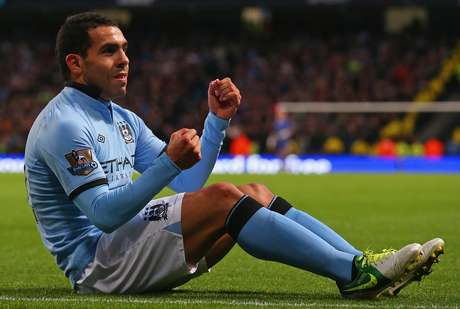 Carlos Tevez drives a car in Manchester City's 5-0 win over Aston Villa.