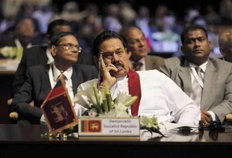 Sri Lanka's President Mahinda Rajapaksa attends the World Energy Forum during the first day of the programme at the Dubai World Trade Centre in this October 22, 2012 file photo. From foreign hotel towers sprouting on Colombo's seafront to the new motorbikes and mobile phones buzzing in war-ravaged Jaffna, at first glance, Sri Lanka seems to be living up to its claim as Asia's latest frontier market. But private businesses are not investing enough, threatening the boom that has swept the island since the end of a long ethnic conflict, while President Mahinda Rajapaksa and his family are tightening their grip on the economy and institutions with what critics see as an unusually personalised system of government.