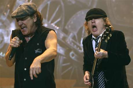 AC/DC lead vocalist Brian Johnson (L) and Angus Young performs at the O2 Millennium Dome stadium in London April 14, 2009.