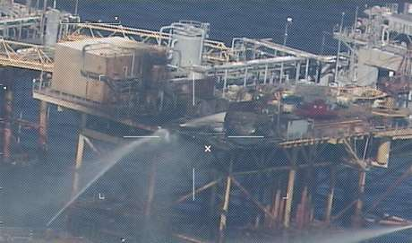 Commercial vessels spray water to extinguish a platform fire on board an offshore oil platform operated by Houston-based Black Elk Energy Offshore Operations LLC. 20 miles offshore of Grand Isle, Louisiana in the Gulf of Mexico November 16, 2012 in this handout photo released by the U.S. Coast Guard.