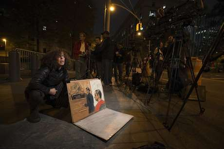 Sketch artist Jane Rosenberg shows reporters her drawing of Gilberto Valle III, 28, when he pleaded not guilty to criminal charges in the U.S. District Court in Manhattan, in New York October 25, 2012.