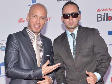 Alexis (left) and Fido pose for the cameras at Premios Billboard in Miami, Florida on April 26, 2012.