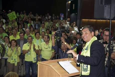 Ecuador's President Rafael Correa (R) addresses supporters as he registers his candidature for the presidential elections at the Supreme Electoral Court in Quito November 12, 2012.
