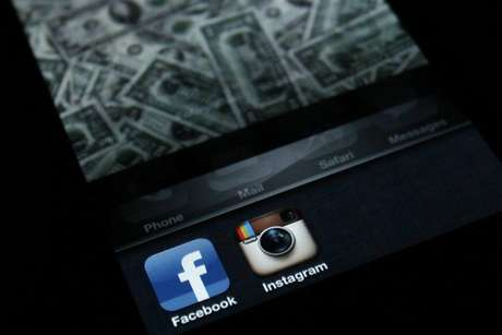 A photo illustration shows the applications Facebook and Instagram on the screen of an iPhone in Zagreb April 9, 2012.
