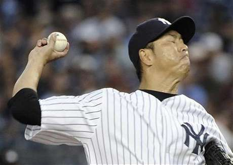 New York Yankees starting pitcher Hiroki Kuroda throws a pitch to the Boston Red Sox in the first inning of their MLB American League game at Yankee Stadium in New York July 29, 2012.