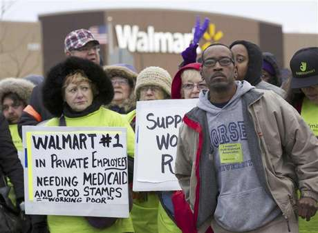 Protesters demonstrate outside a Walmart store in Chicago November 23, 2012. Black Friday, the day following the Thanksgiving Day holiday, has traditionally been the busiest shopping day in the United States.