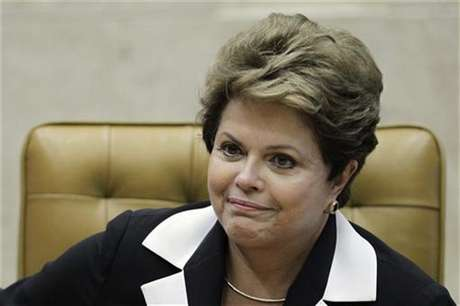 Brazil's President Dilma Rousseff participates in the ceremony of investiture for the new President and Vice-President of the Supreme Court, ministers Joaquim Barbosa and Ricardo Lewandowski, in Brasilia November 22, 2012.