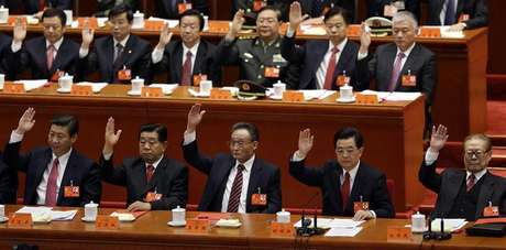 (Front row, from L to R) China's Vice President Xi Jinping, top political advisor Jia Qinglin, chairman of the Standing Committee of National People's Congress Wu Bangguo, China's President Hu Jintao and former President Jiang Zemin raise their hands as they take a vote at the closing session of the 18th National Congress of the Communist Party of China at the Great Hall of the People in Beijing, November 14, 2012.
