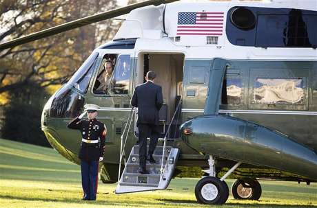 U.S. President Barack Obama boards Marine One before departing for a trip to Thailand, Burma and Cambodia from the White House in Washington November 17, 2012.