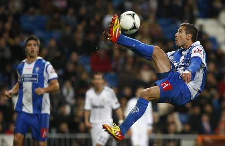 Alcoyano's Javi Selvas kicks the ball during their Spanish King's Cup soccer match against real Madrid at Santiago Bernabeu stadium in Madrid November 27, 2012. REUTERS/Juan Medina