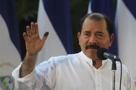 Nicaragua's President Daniel Ortega speaks to supporters after casting his vote in the municipal elections at a polling station in Managua November 4, 2012.