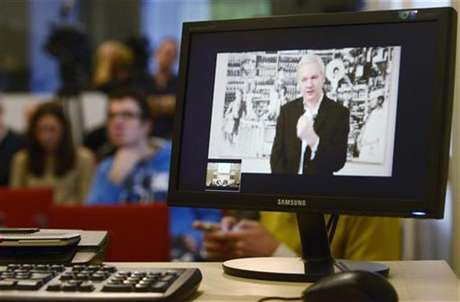 WikiLeaks founder Julian Assange, speaking during a teleconference from Ecuador's embassy in central London, is pictured on a screen during a news conference in Brussels November 27, 2012.