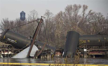 Derailed freight train cars sit semi-submerged in the waters of Mantua Creek in Paulsboro, New Jersey, November 30, 2012. A rail bridge collapsed on Friday over a creek in southern New Jersey, causing a Conrail freight train to derail and spill hazardous chemicals into the water, authorities said. Five tanks of the freight train, which was carrying vinyl chloride, fell into the Mantua Creek, which feeds into the Delaware River near Philadelphia, the U.S. Coast Guard said.