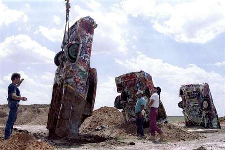 "One of ten Cadillac automobiles from the ""Cadillac Ranch"" art installation is lowered into the ground at its new home near Amarillo, Texas, in this August 21, 1997 file photo. Eccentric Texas oil millionaire Stanley Marsh 3 has been indicted on child molestation charges in Amarillo and was released after posting a bond, according to court records, November 29, 2012. Marsh, 74, who considers the Roman numerals ""III"" to be pretentious and prefers the suffix ""3,"" is best known as the owner of the iconic Cadillac Ranch, a work of public art featuring 10 brightly painted Cadillac cars buried nose-first in the ground along Interstate 40 in the Texas Panhandle."
