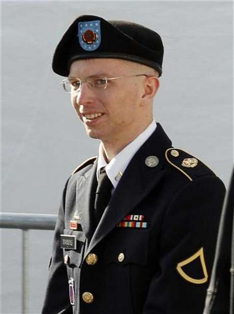 Army Private First Class Bradley Manning is escorted in handcuffs as he leaves the courthouse in Fort Meade, Maryland June 6, 2012.