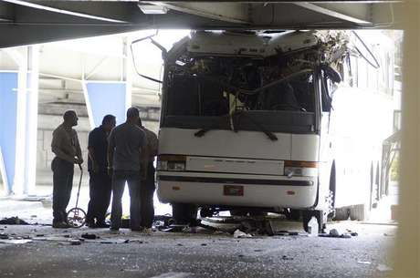 Miami International Airport Police and fire rescue personnel investigate the crash of a tour bus containing 30 passengers that struck an overpass at the Miami International Airport, Florida December 1, 2012. At least one person was killed and the seven injured were taken to a hospital.