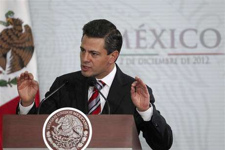 Mexico's President Enrique Pena Nieto gestures during the National Sports Award ceremony at Los Pinos Presidential Palace in Mexico City December 2, 2012.