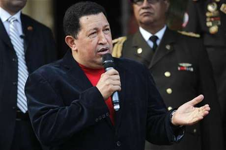 Venezuela's President Hugo Chavez talks to the media after a meeting with Brazil's Foreign Minister Antonio Patriota at the Miraflores Palace in Caracas November 1, 2012.