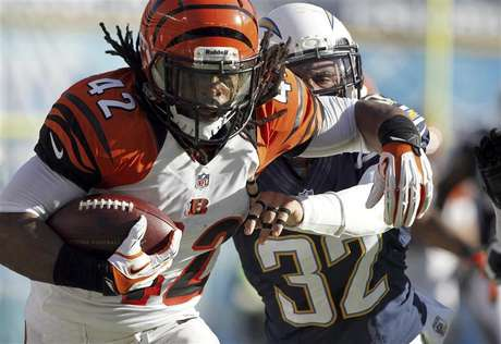 Cincinnati Bengals running back BenJarvus Green-Ellis (42) is pushed out-of-bounds by San Diego Chargers free safety Eric Weddle (32) after a 41-yard run in the first half of their NFL football game in San Diego, California December 2, 2012.