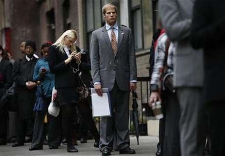 Job seekers stand in line to meet with prospective employers at a career fair in New York City, October 24, 2012.