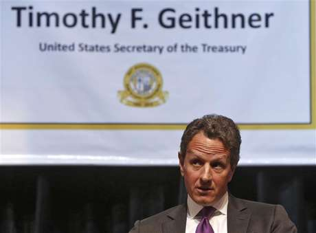 "U.S. Treasury Secretary Tim Geithner gestures as he is interviewed by Bob Schieffer (not pictured) in Washington, on November 30, 2012 for the December 2, 2012 edition of ""Face the Nation"" in this CBS handout."