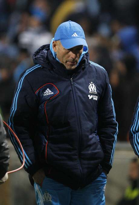 Olympique Marseille's coach Elie Baup reacts after their French Ligue 1 soccer match against FC Lorient at the Velodrome Stadium in Marseille, December 9, 2012.