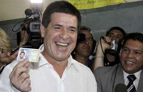 Horacio Cartes from the Colorado Party shows his identity card before voting in the primaries of the party in Asuncion December 9, 2012. The Colorado Party will choose its presidential candidate on Sunday, to represent the party in the April 2013 elections.