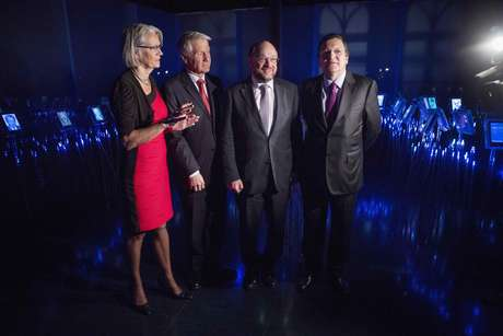 (From L-R) Executive Director of the Nobel Peace Center Bente Erichsen, Chair of the Norwegian Nobel Committee Thorbjorn Jagland, European Parliament President Martin Schulz and European Commission President Jose Manuel Barroso pose for a picture during the opening of an exhibition at the Nobel Peace Center in Oslo December 11, 2012. The European Union received the Nobel Peace Prize on Monday, an award which some past winners called unjustified but European leaders defended for recognising the stability and democracy brought to the continent after two world wars.