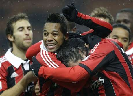 AC Milan players celebrate after a goal in their 3-0 win over Reggina in the Italian Cup on Thursday.