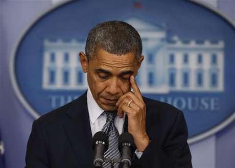 O presidente norte-americano, Barack Obama, faz uma declaração na sala de imprensa da Casa Branca sobre o tiroteio numa escola primária em Connecticut, nesta sexta-feira, em Washington, nos Estados Unidos. 14/12/2012